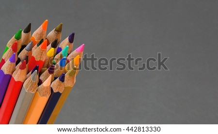 Color pencils several bars. on black background  - stock photo