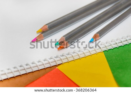 color pencils with album on colour paper