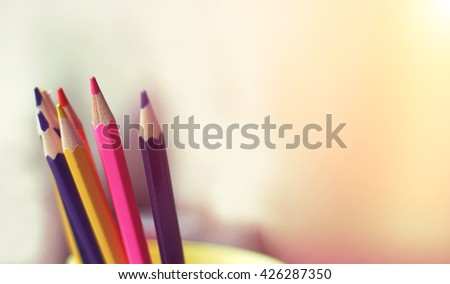 Color pencils. Wooden pencil - concept. Copy space - blurred background. Toned image. - stock photo
