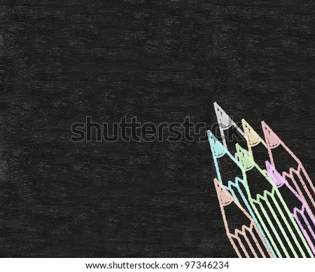 color pencils written on blackboard background - stock photo
