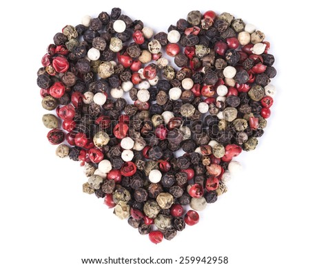 Color pepper mixed spices heart shaped  isolated on white background - stock photo