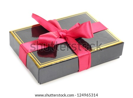 Color photo of a black cardboard box and bow
