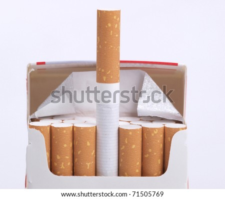 Color photo of a cardboard packet and filter cigarettes - stock photo