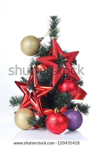Color photo of a Christmas tree and Christmas toys - stock photo