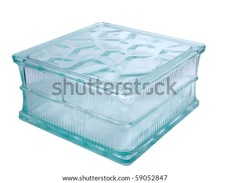 Color photo of a glass block for construction on a white background