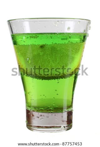 Color photo of a glass cup with a cocktail