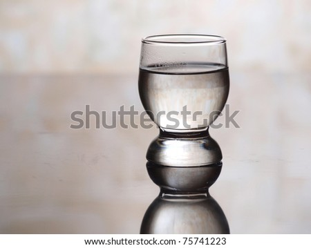 Color photo of a glass cup with tequila - stock photo