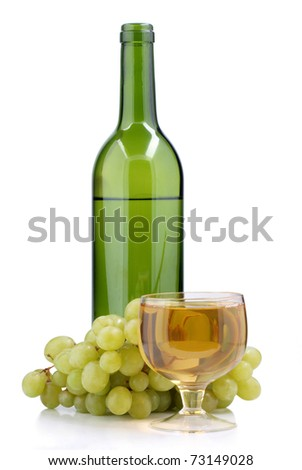 Color photo of a glass of wine and grapes