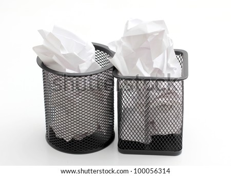 Color photo of a metal basket and paper