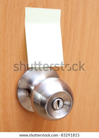 Color photo of a metal handle on a wooden door and blank - stock photo