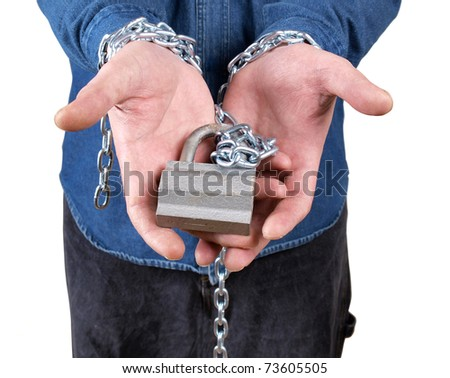 Color photo of a prisoner with a chain on his hands - stock photo