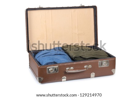 Color photo of an old suitcase with clothing - stock photo