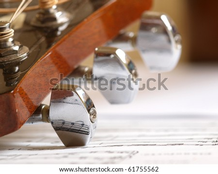Color photo of an strings acoustic guitar and music note - stock photo
