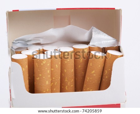 Color photo of filter cigarettes on white