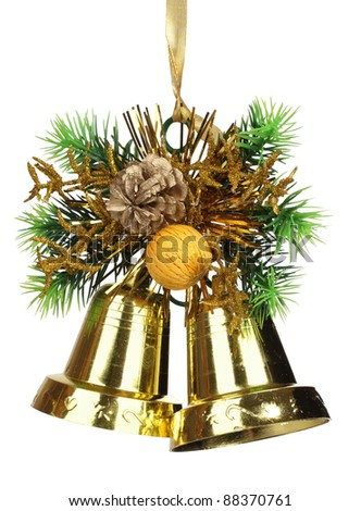 Color photo of golden bells and branches of pine needles - stock photo