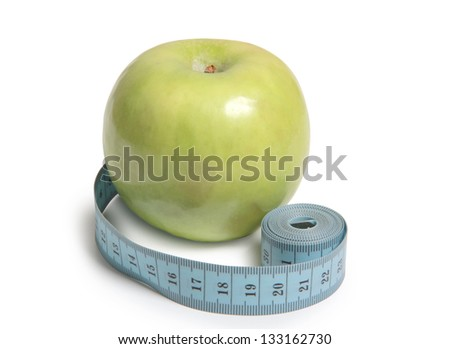 Color photo of green apple and measuring tape