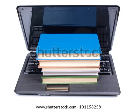 Color photo of old book and computer - stock photo