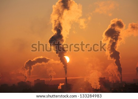 Color photo of smoke from industrial chimney at dawn