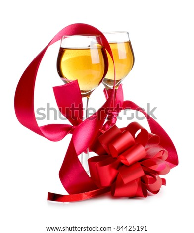 Color photo of wine glasses and a red ribbon