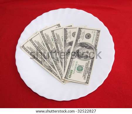 color photo paper money. Isolated on a red background.