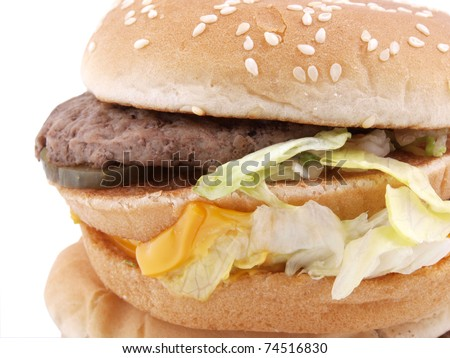 Color photograph of a large hamburger on a white background