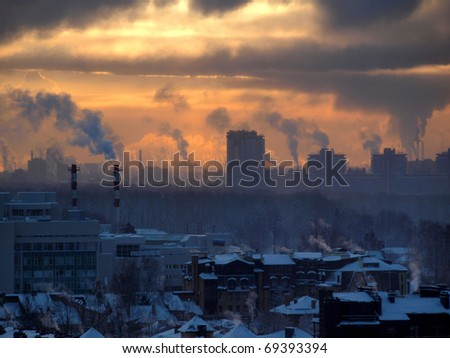 Color photograph of industrial buildings at sunset - stock photo