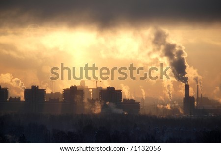 Color photograph of industrial buildings at sunset sky - stock photo