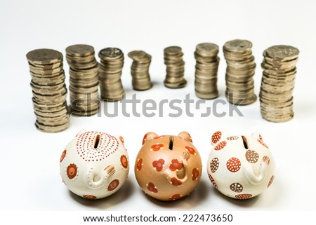 Color photograph of Piggy Bank and coins - stock photo