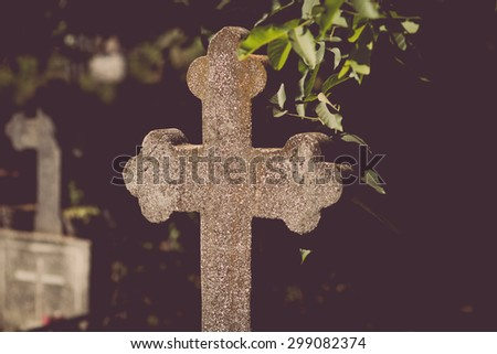 Color picture of a stone cross in a graveyard