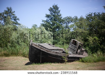 Color picture of a stranded wooden boat