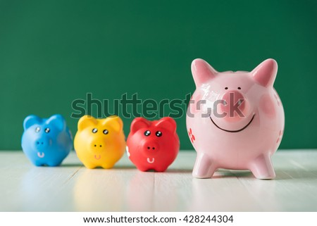 color piggy bank on green background