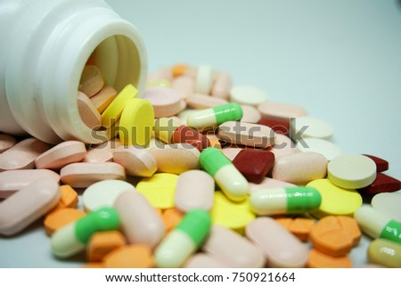 Color pill bottle on white background.