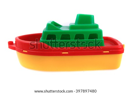 color plastic ship toy isolated on the white background