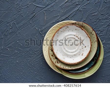 color plates, saucers. selective focus - stock photo