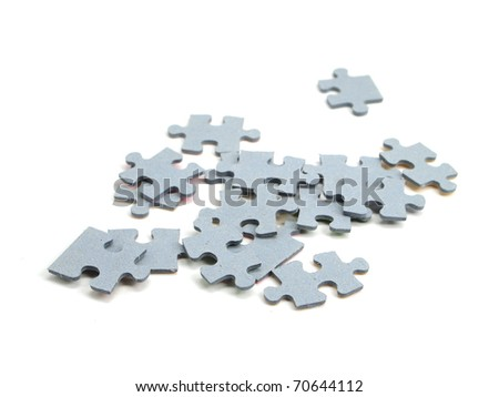 color puzzle pieces on the white background - stock photo