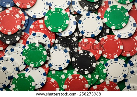 color red blue green white poker chips background - stock photo