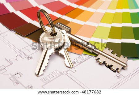 Color samples for selection with house keys and a blueprint