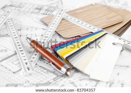 color samples of architectural materials - plastics,  metric folding ruler, pencil & architectural drawings of the modern house - stock photo