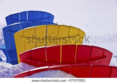 color-seat chairs in the snow - stock photo