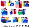 color shopping bags with clothing isolated on white with reflection - stock photo
