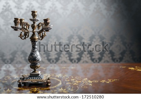 Color shot of a beautiful vintage candlestick - stock photo