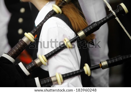 Color shot of a person holding a traditional bagpipe. - stock photo