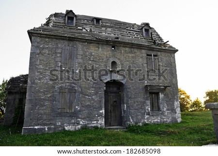 Color shot of an abandoned big house. - stock photo