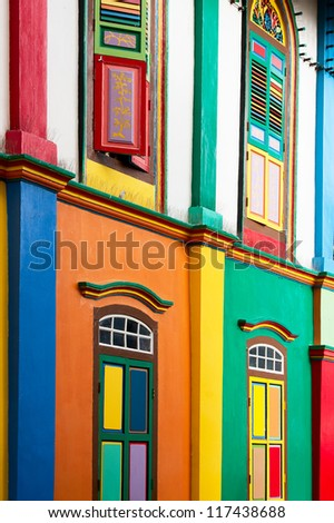 Color shutters and color facade of building in Little India, Singapore - stock photo