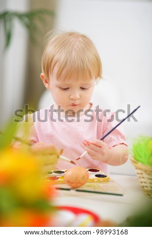 Color smeared baby painting Easter egg - stock photo