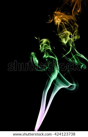 Color smoke on black background from the incense sticks