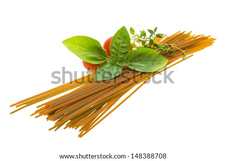 Color spaghetti with basil, thyme and tomato isolated - stock photo