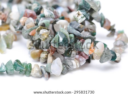 Color spectrum of semi precious gemstones, on white background - stock photo