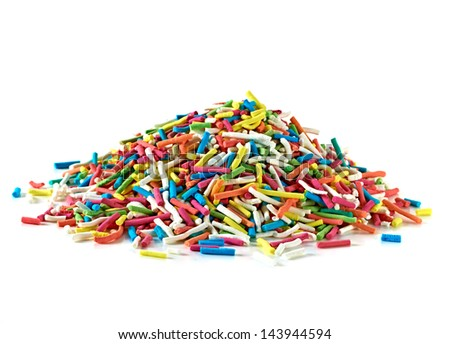 Color sprinkles pile on white background - stock photo