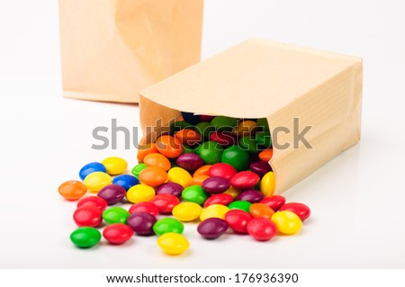 Color sweets in a paper bag - stock photo